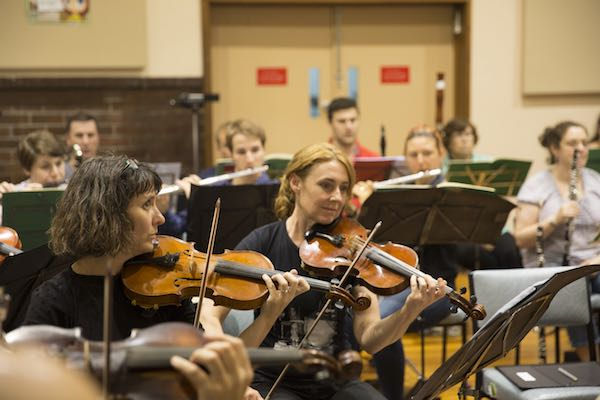 strings-and-woodwinds-in-rehearsal