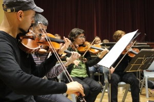 Photo of violinists rehearsing